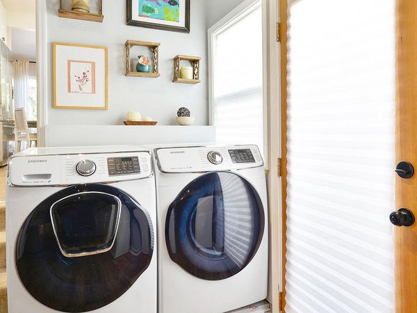 Small laundry room in a corner