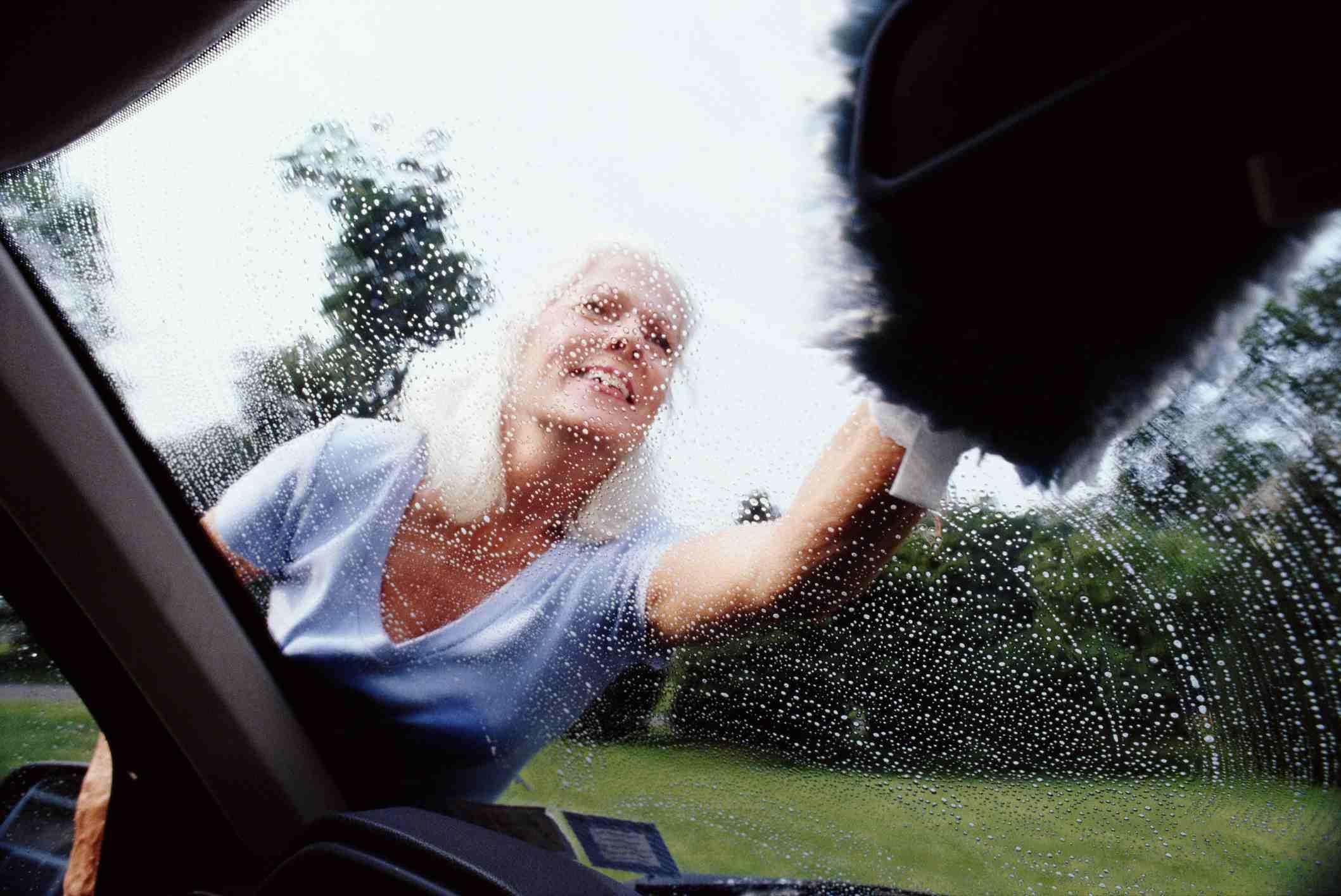 woman washing car window