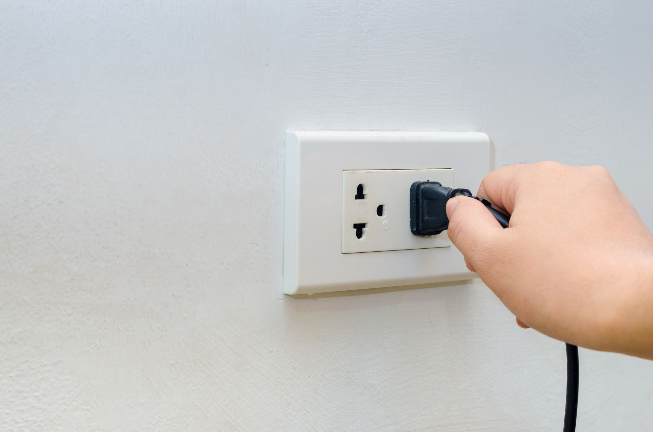 How To Prevent Electrical Shock Wiring A Switch Off Plug Hand Outlet Power Saving Inserting Into