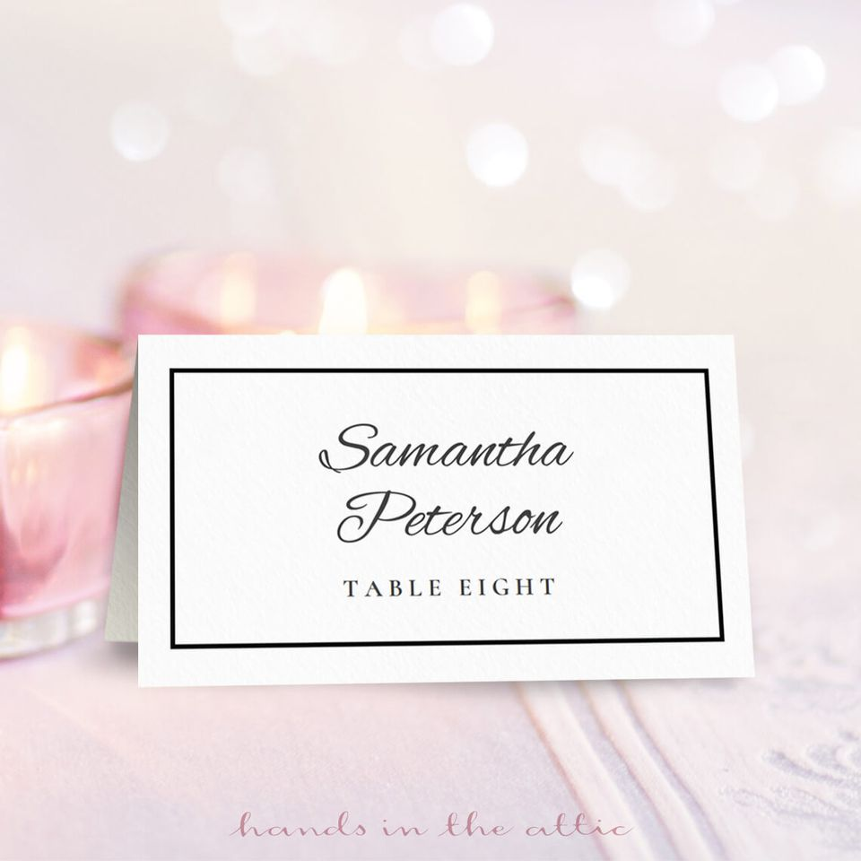 A black and white wedding place card