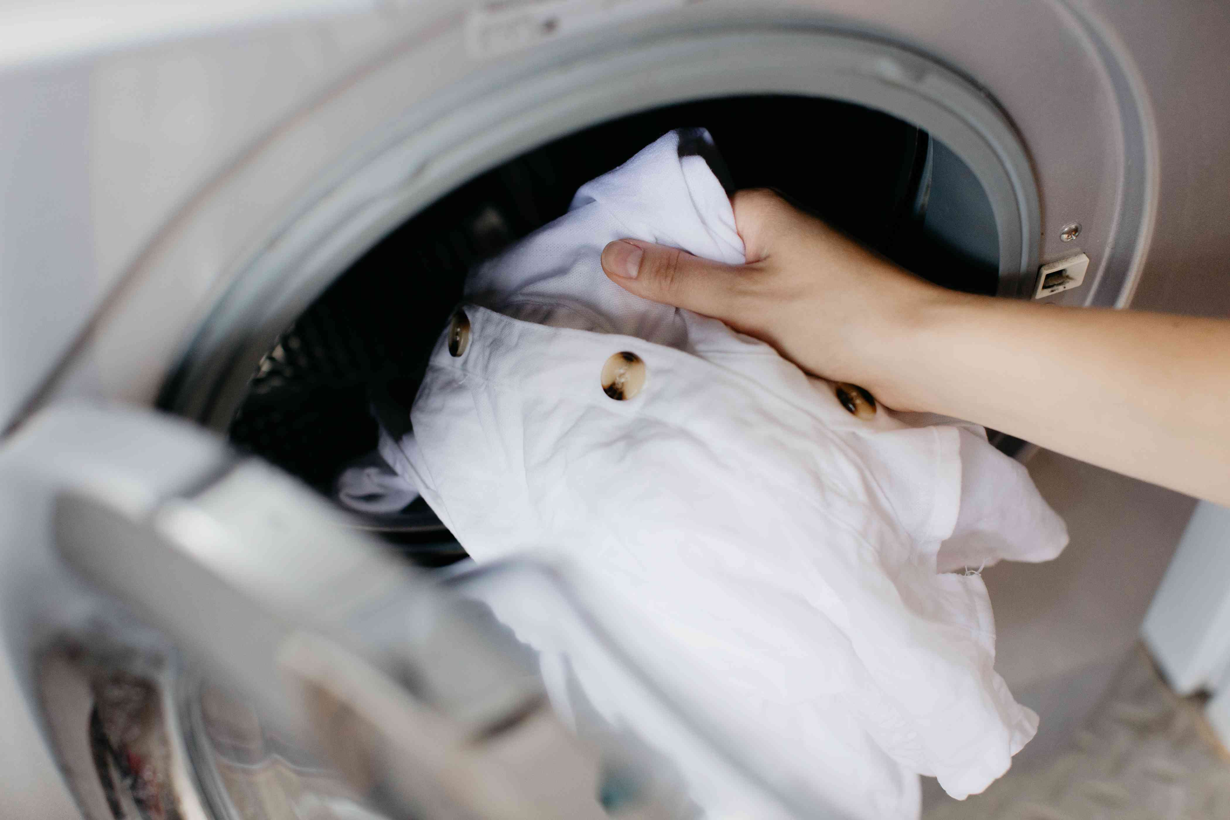 washing the garment per the care tag instructions
