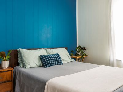 deep blue accent wall in a bedroom