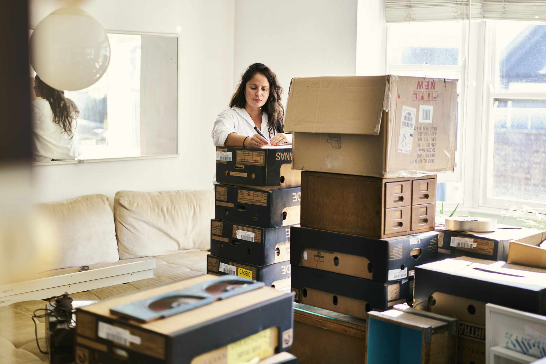 Woman labeling boxes for a move