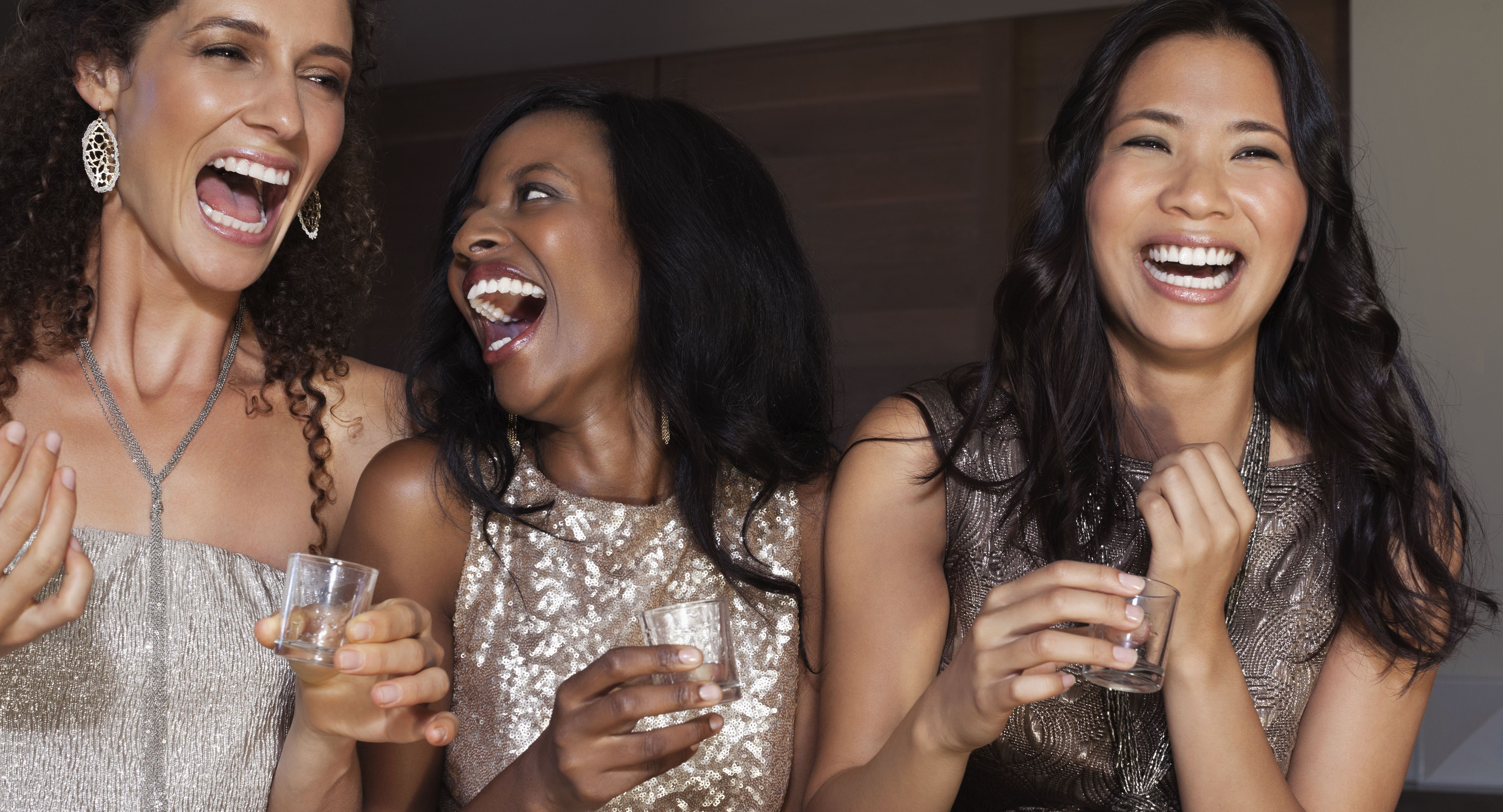 Women laughing together at party