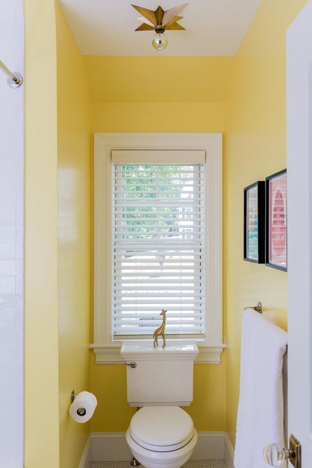 small yellow powder room with star light fixture