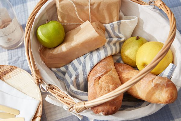 Picnic basket with fruit and bread