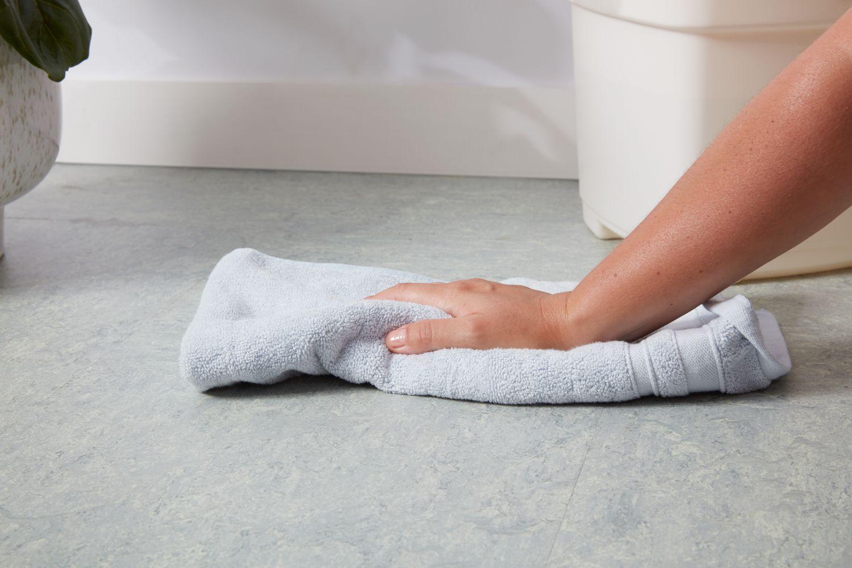 Drying towel on linoleum floor