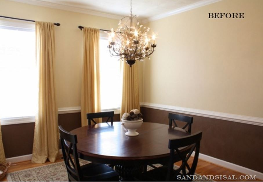 Small traditional dining room with circular dining table in dark wood.