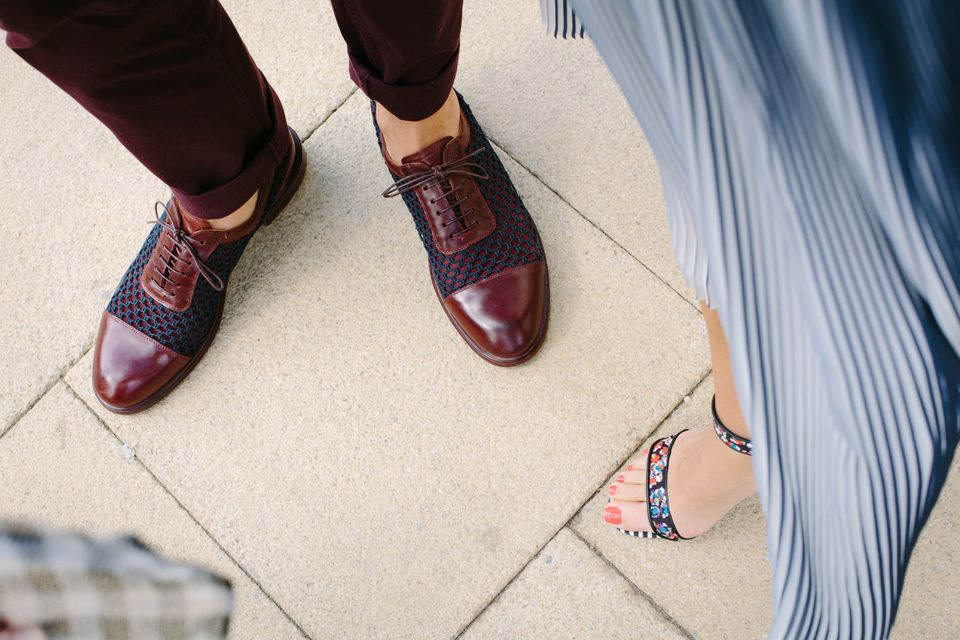 Two pairs of feet with semi-formal dress