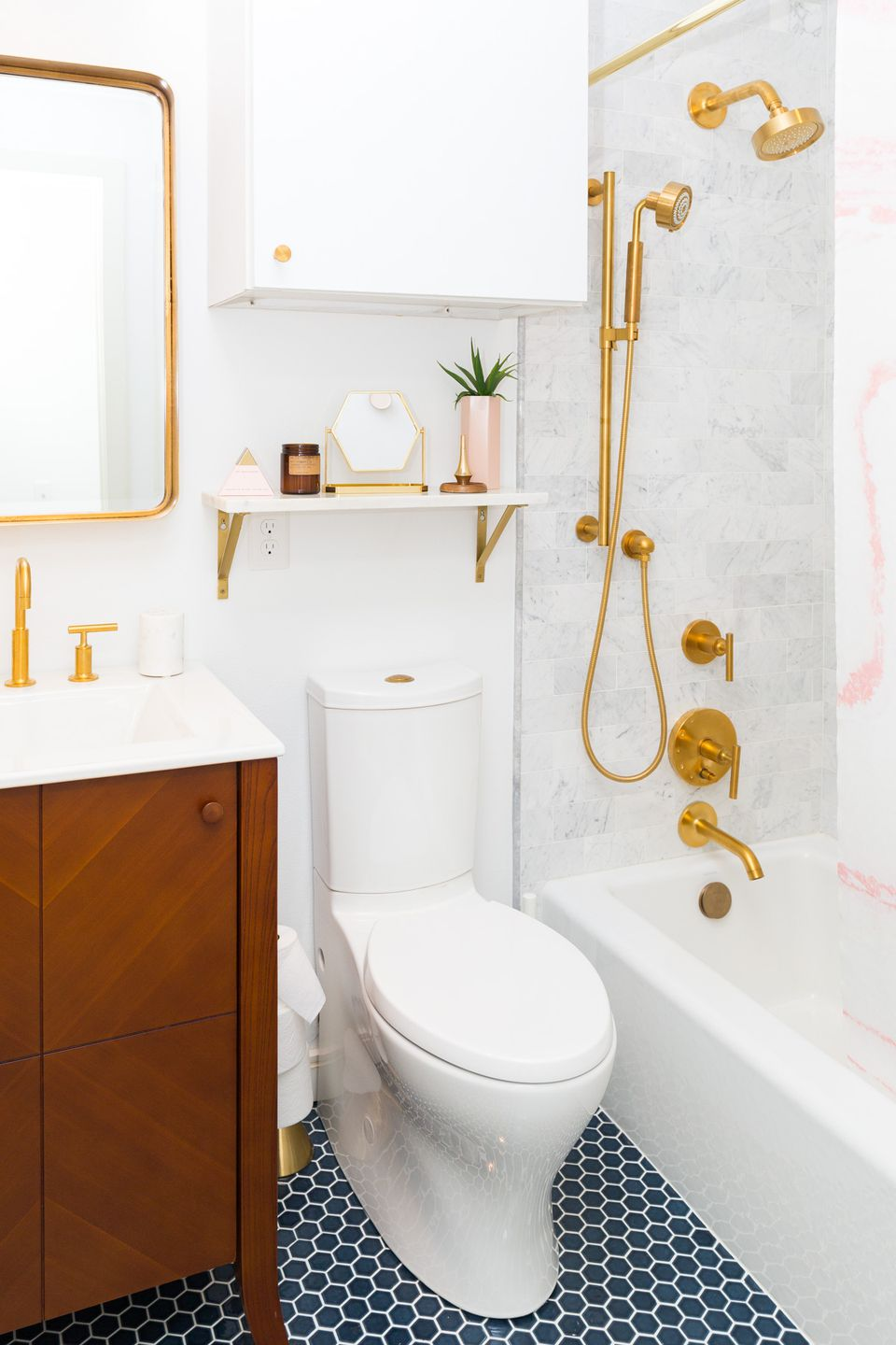 bathroom with gold fixtures