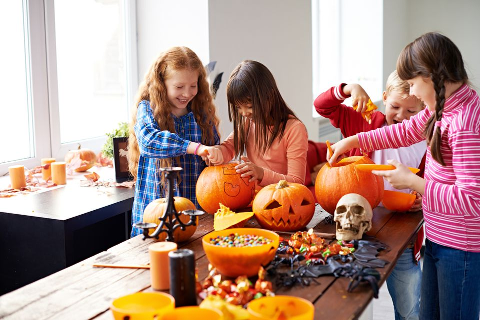 Children making Halloween decoration for trick or treat