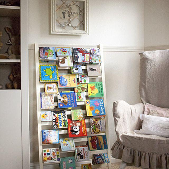 Crib-rail repurposed as a book rack