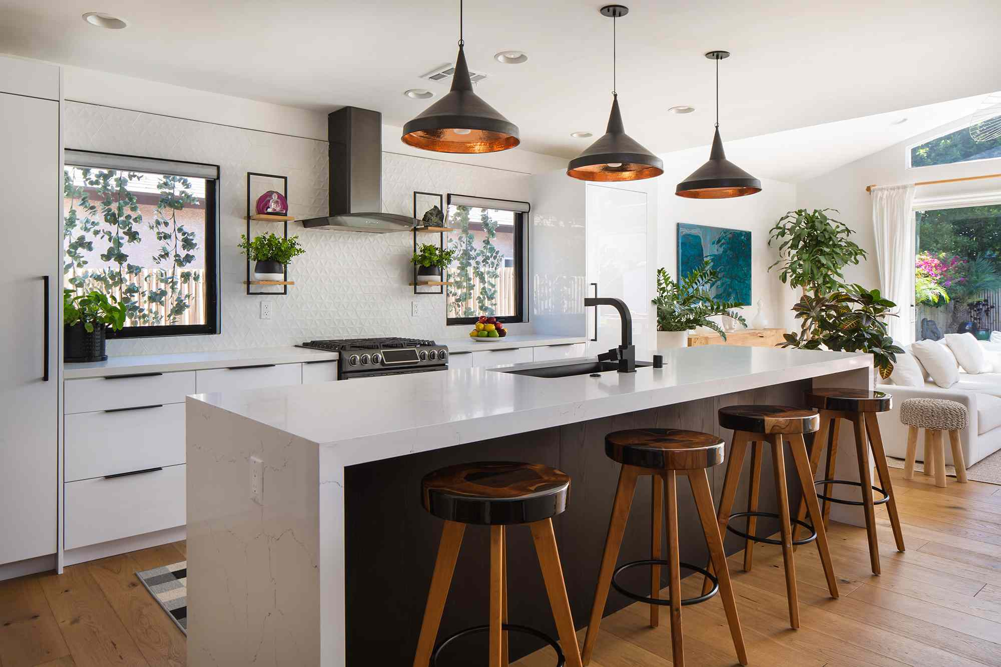Open plan white kitchen with a large island