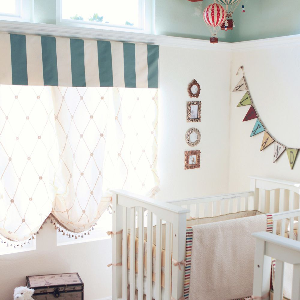 Vintage twin nursery with carnival theme