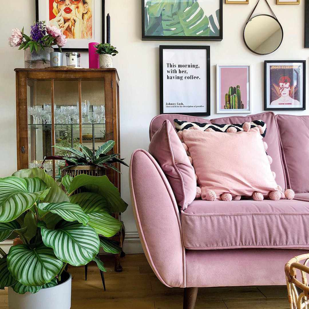 Living room with a pink velvet sofa