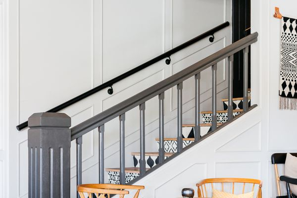 Painted staircase with gray railing and black and white patterned steps