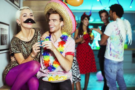 couple wearing costumes at party
