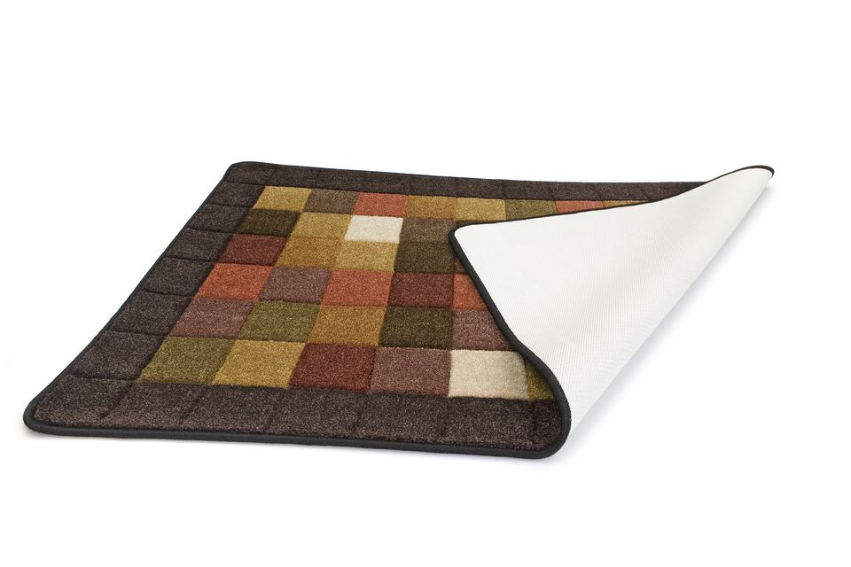 An area rug, folded over with a cushion
