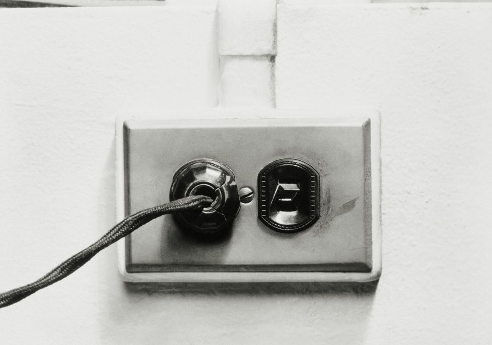 PLUG IN AN ELECTRICAL WALL OUTLET, 1950S