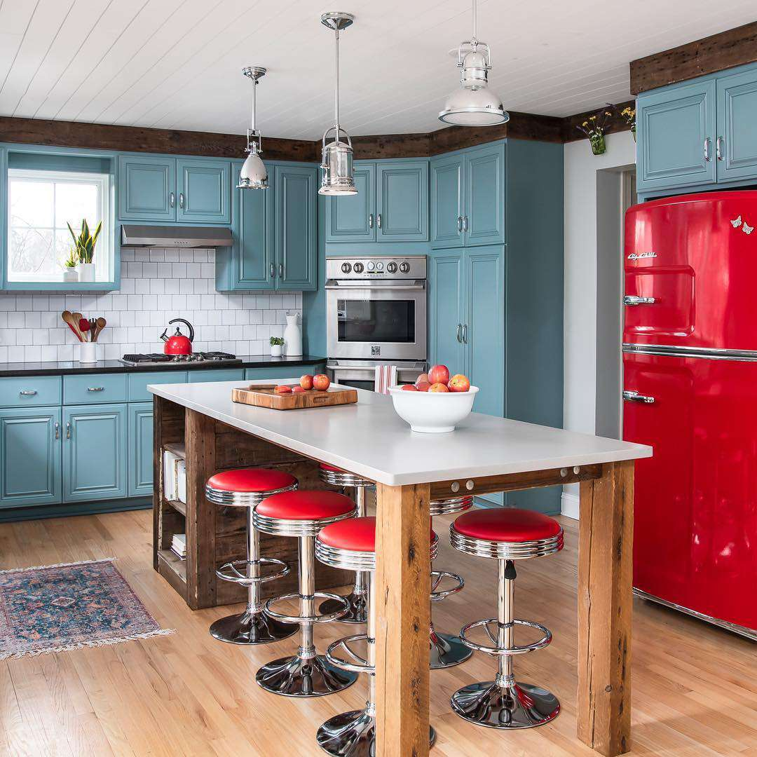Teal kitchen with red appliances