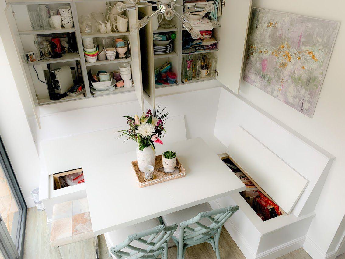 hidden storage in kitchen banquettte