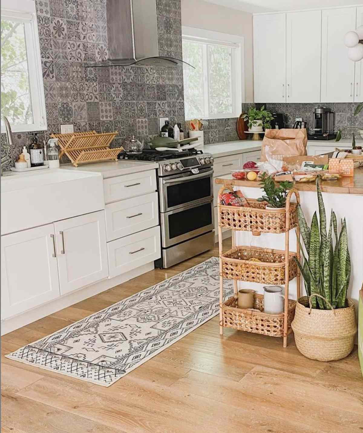 set of wicker baskets holding various kitchen items including cookbooks