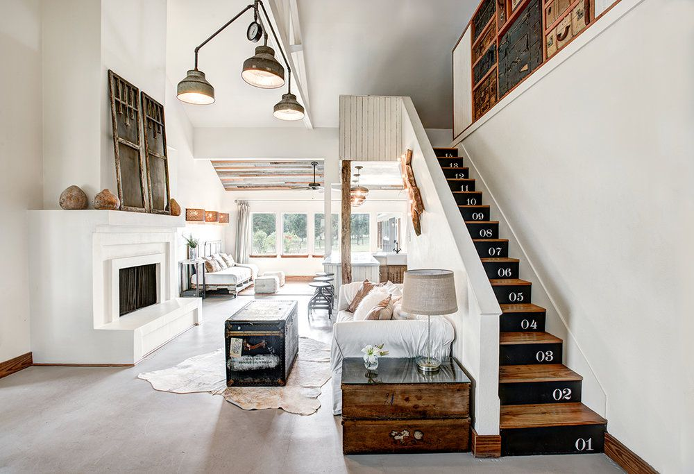living room with black and white painted stairs