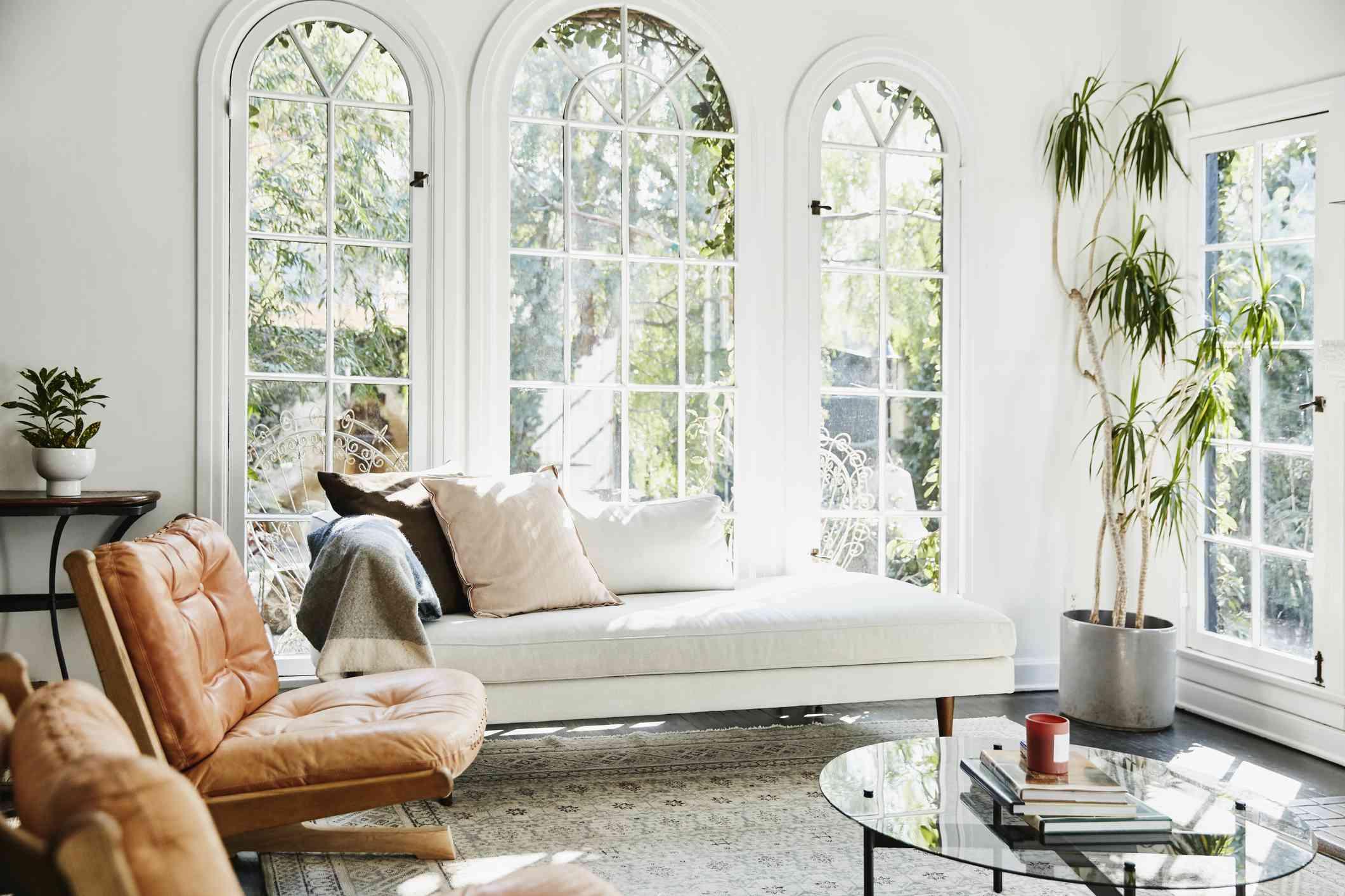 A crisp, white room with big windows.