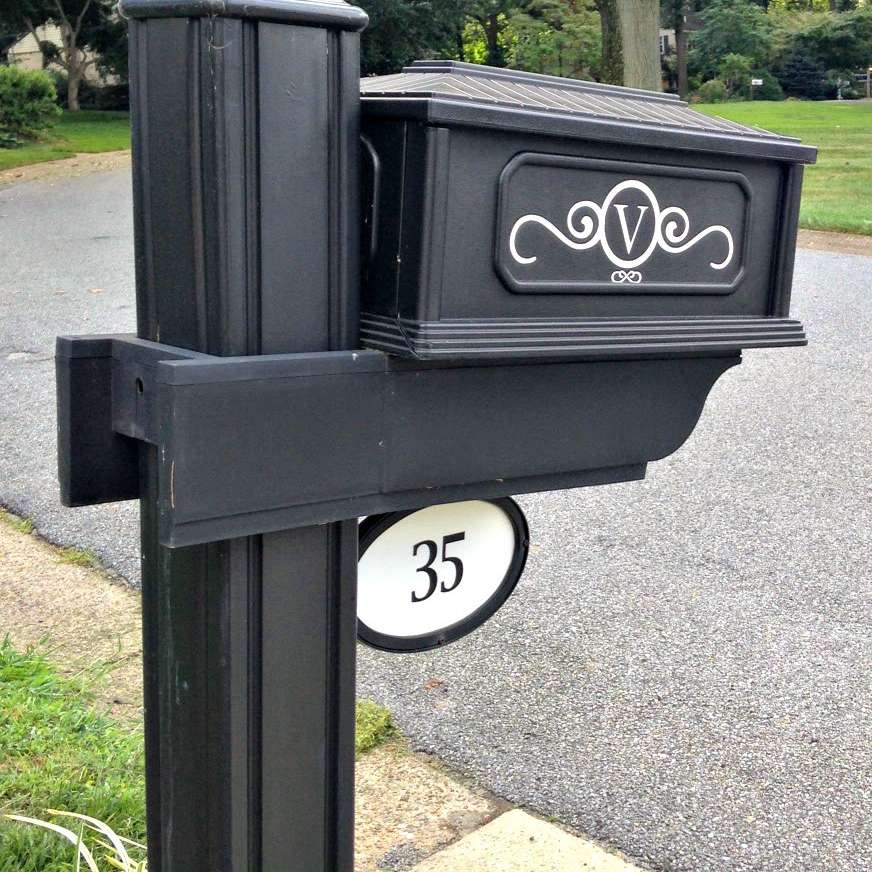 Address number decals on a black mailbox.