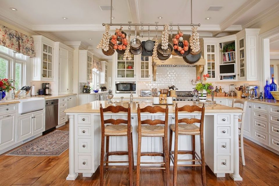 traditional white kitchen with limestone countertops