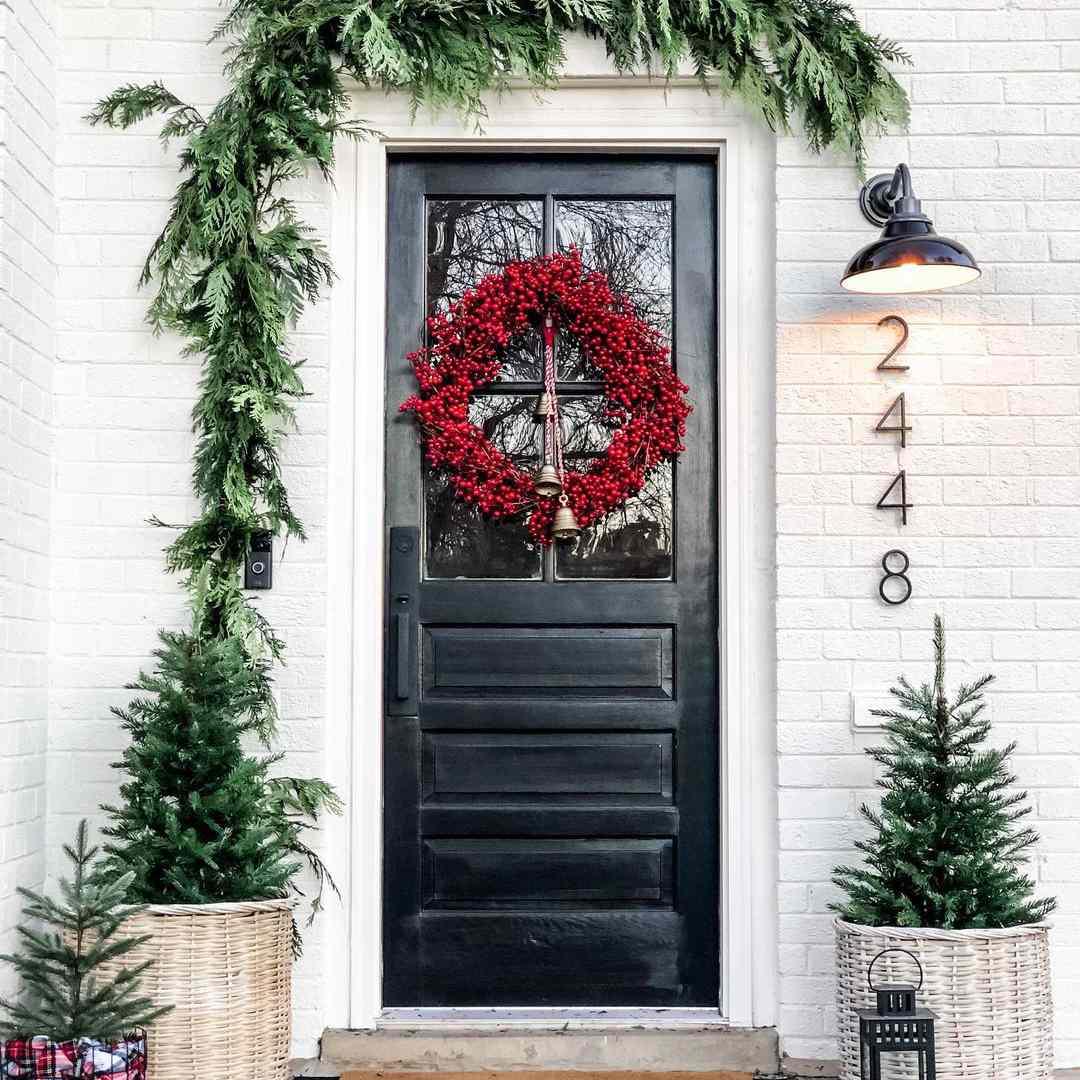 Black door with red wreath