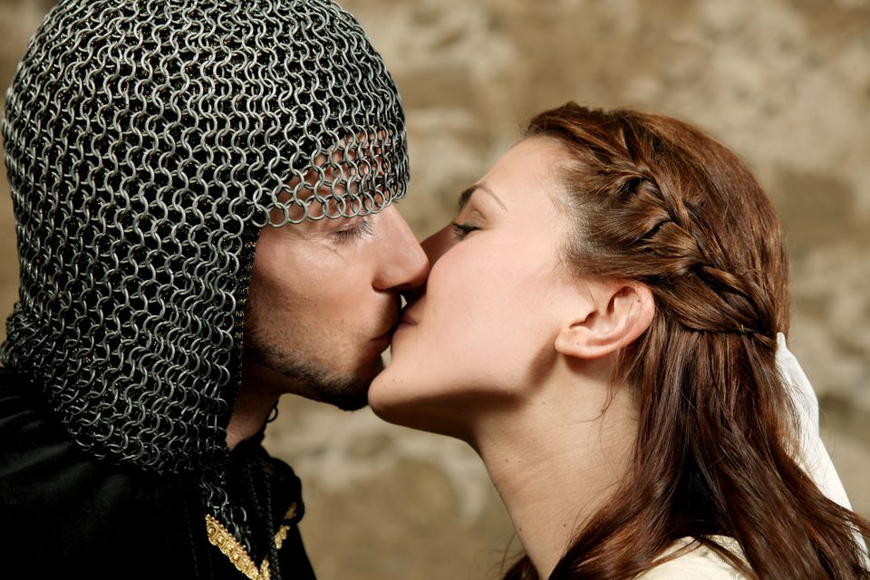 Young medieval couple, soldier and maid, kissing