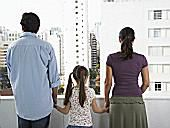 Family looking at apartment buildings