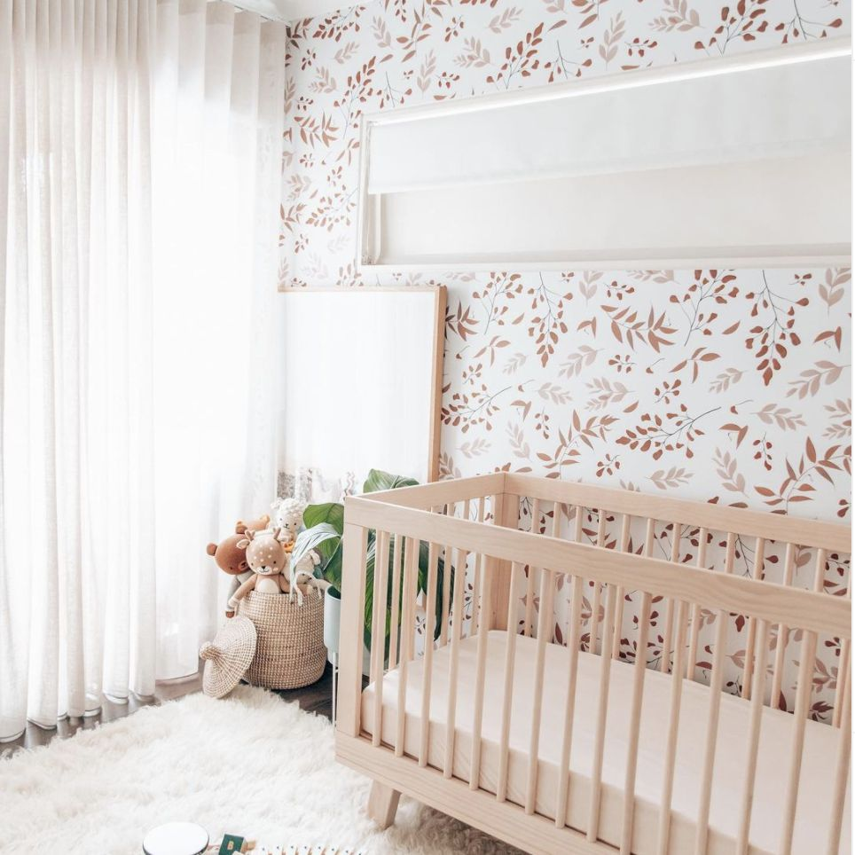 red and pink leaves wallpaper with fluffy rug on floor, long white linen curtains