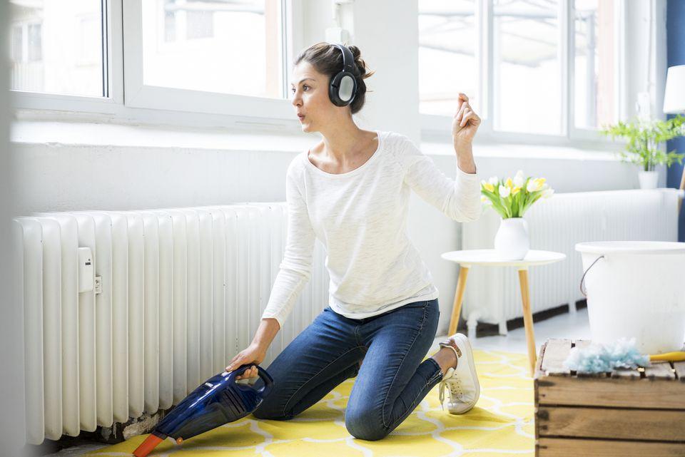 woman using handheld vacuum