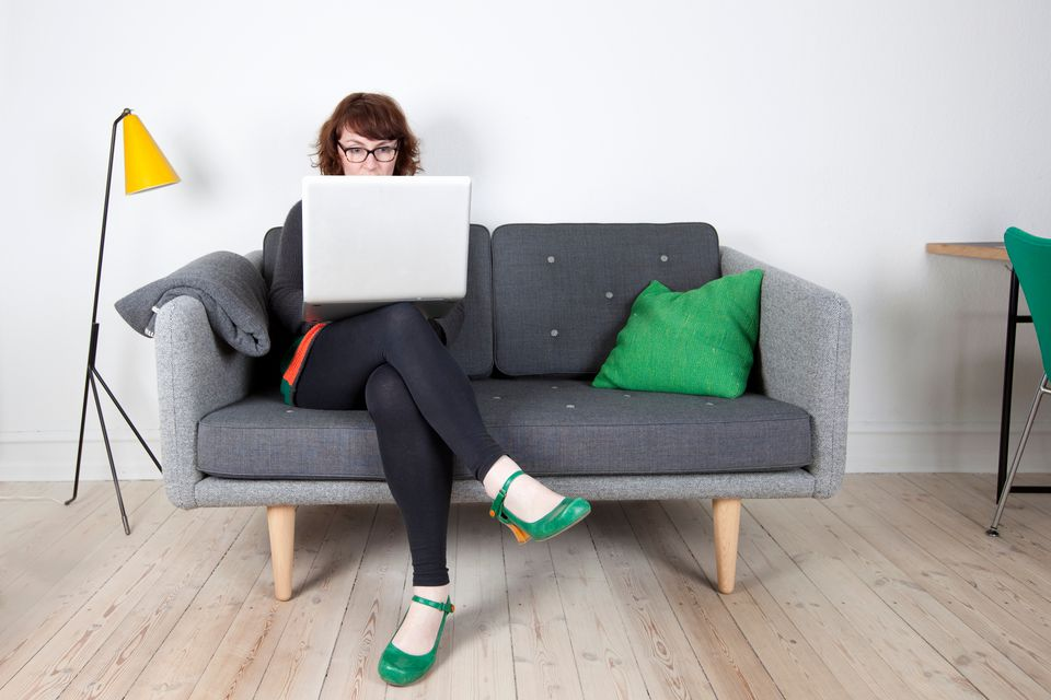 Woman browsing online yard sale on laptop
