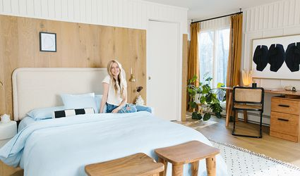Sarah Sherman Samuel poses in her redecorated guest bedroom-office area with items from Etsy