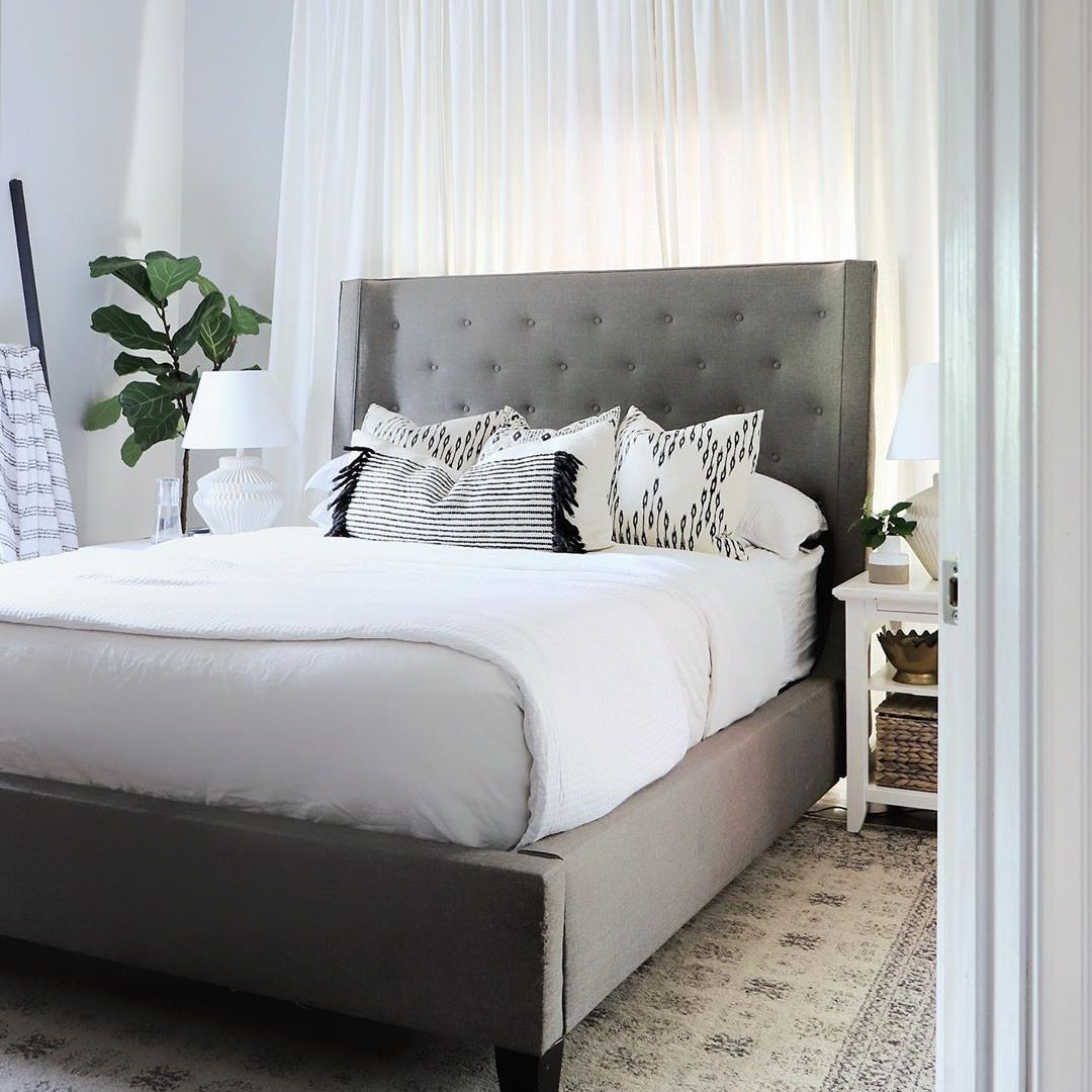 Bedroom with gray bed