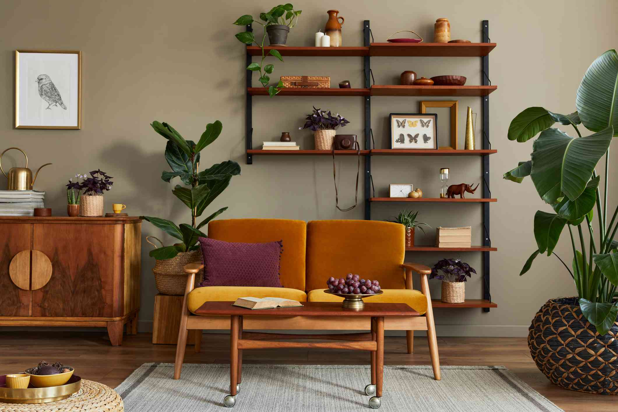 A living room with vintage furniture and plants