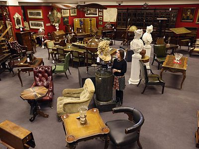 A lobby filled with furniture for sale