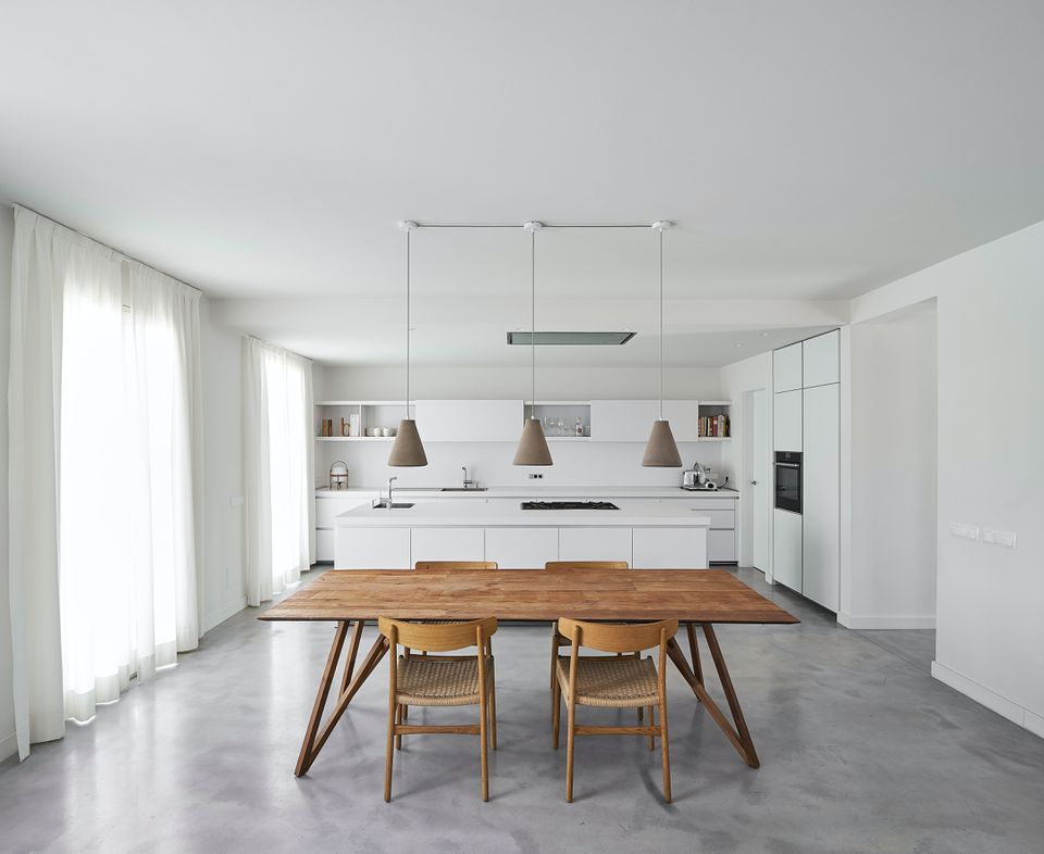 white minimalist kitchen with wood table