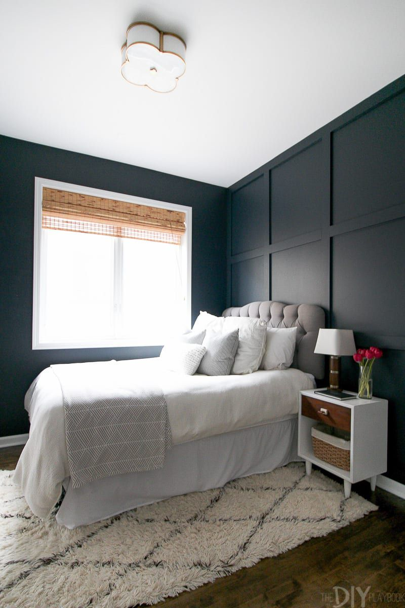 Bedroom with dark blue paint
