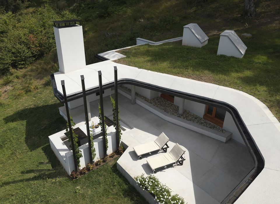 Aerial view of modern house with shaded terrace, UK home