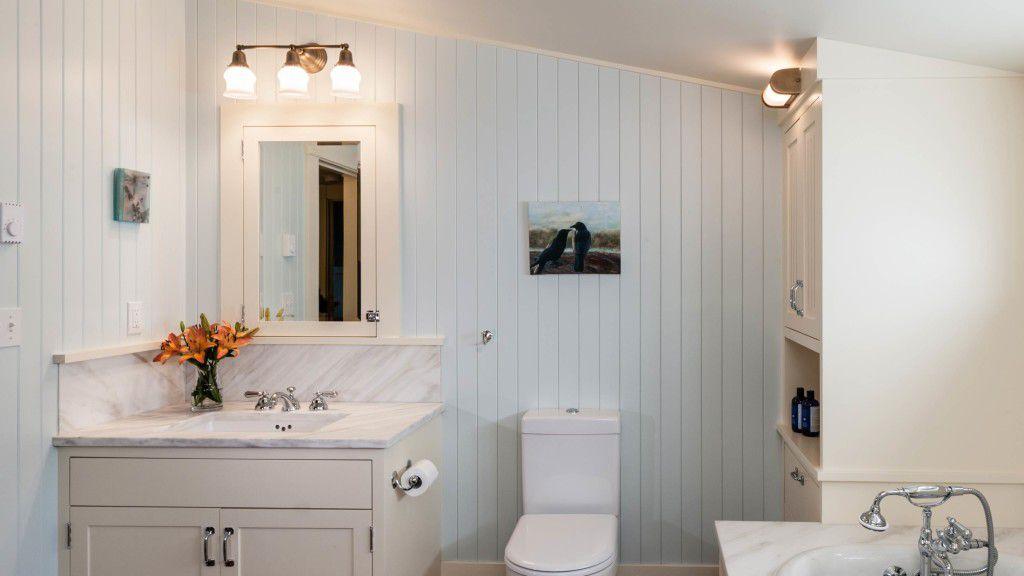 White and light blue attic bathroom