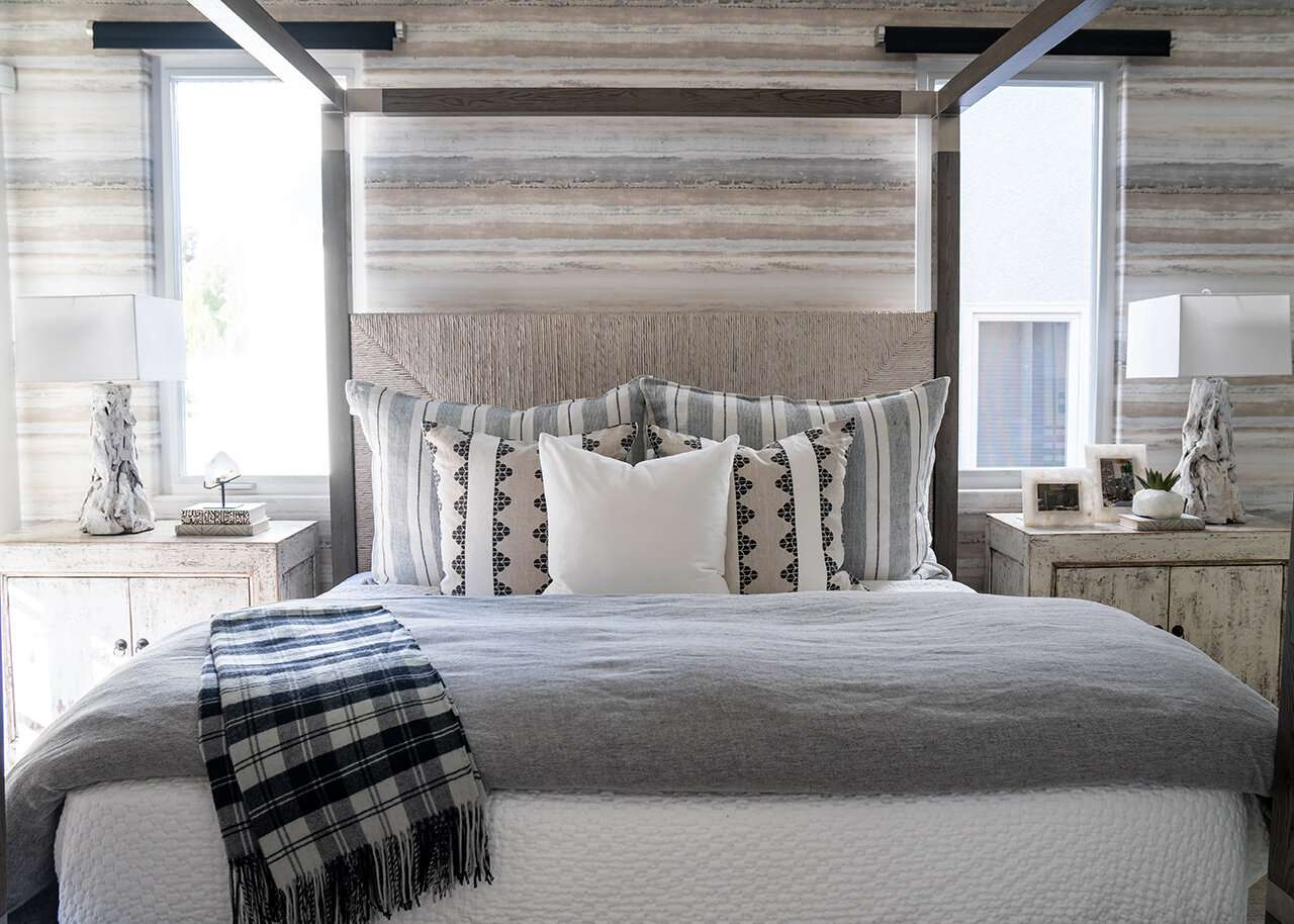 neutral bedroom with multiple patterns