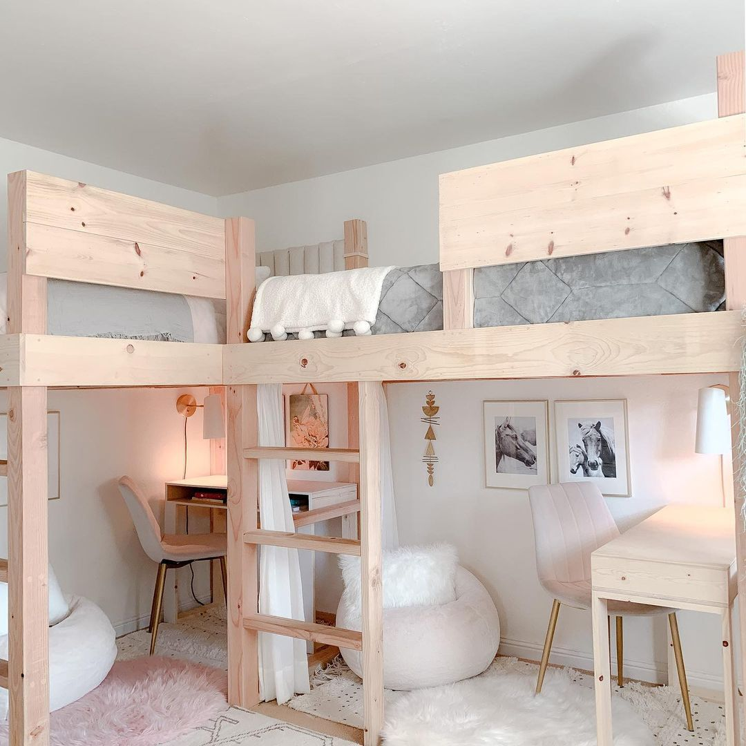A loft bed for two girls with a curtain separating each girl's space