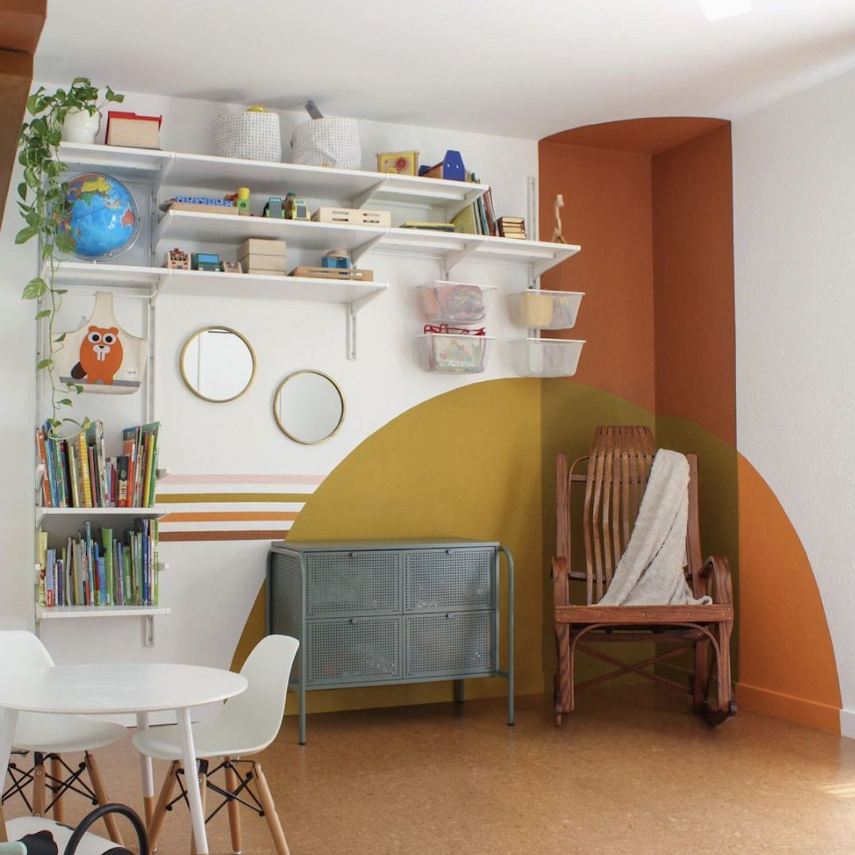 kids workspace with painted mural in the corner