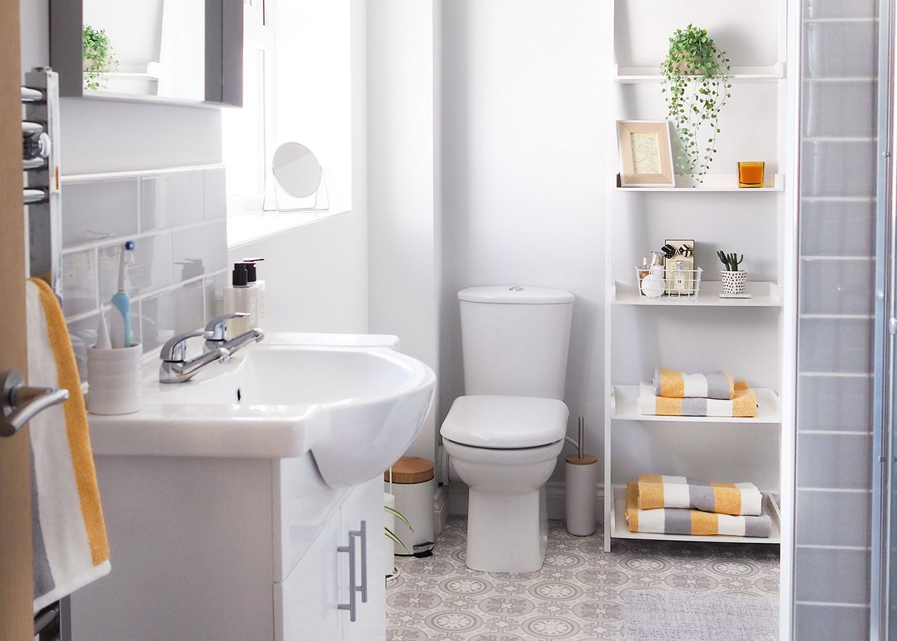bathroom with yellow and gray accents