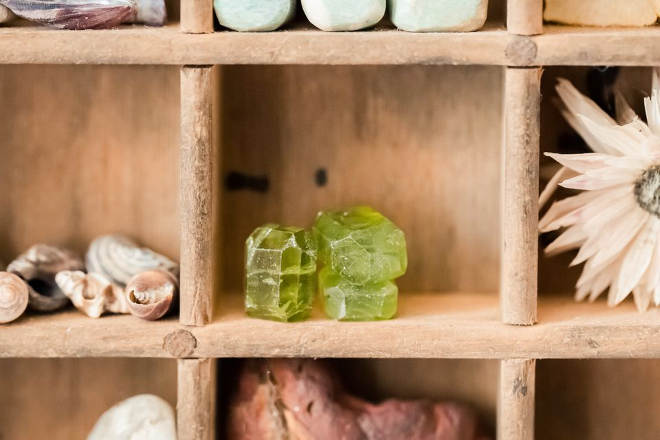 peridot crystals on a shelf