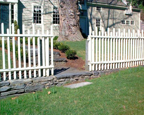 Photo of fence with varying board heights.